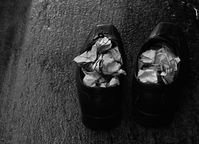 sabates molles amb diari a dins